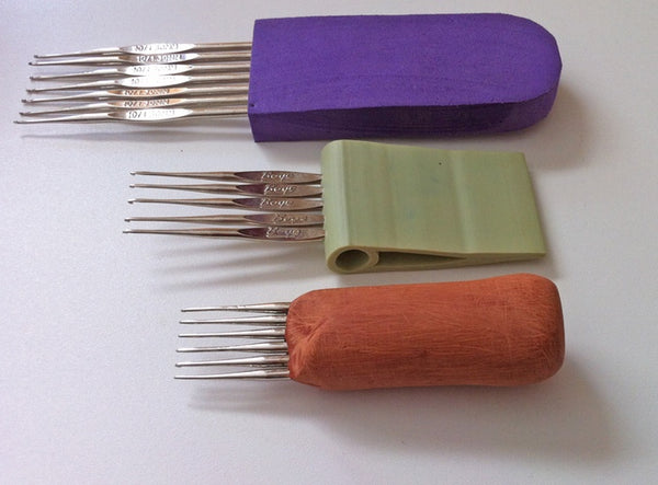The first three prototypes of the CoatHook Undercoat Pet Comb
