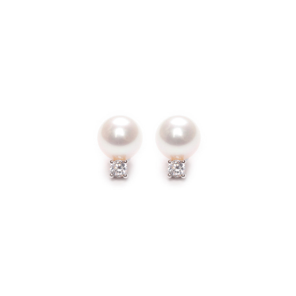 Cubic zirconia and sterling silver earring accessory, to be worn with a stud and scroll behind the ear.