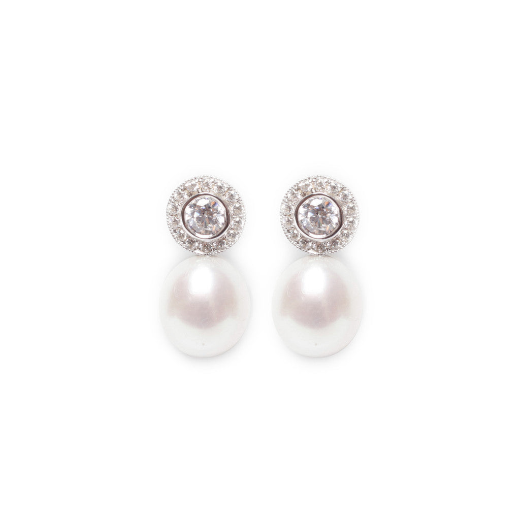 Elegant round cubic zirconia and freshwater pearl stud earrings in sterling silver.