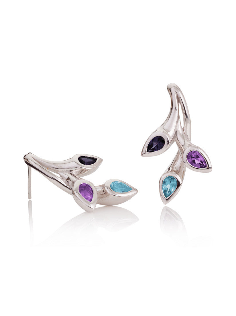 Rhodium plated sterling silver earrings set with a sparkling Amethyst, a Blue Topaz and an exquisite Iolite.
