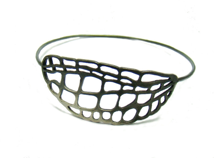 Summer bangle by British designer Kokkino featuring a hand-pierced lacewing motif in solid sterling silver.