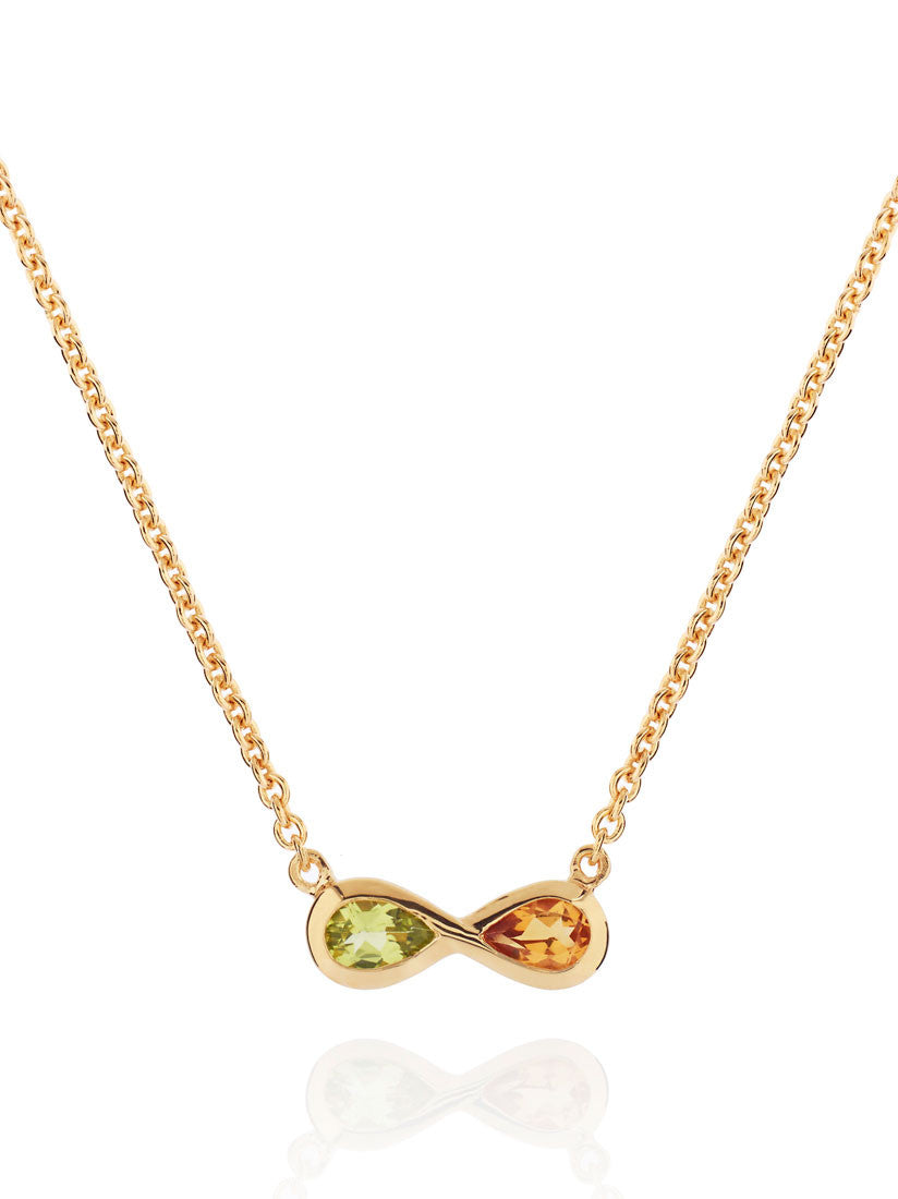 A symbol of love: MANJA's golden gemstone necklace with infinity symbol.