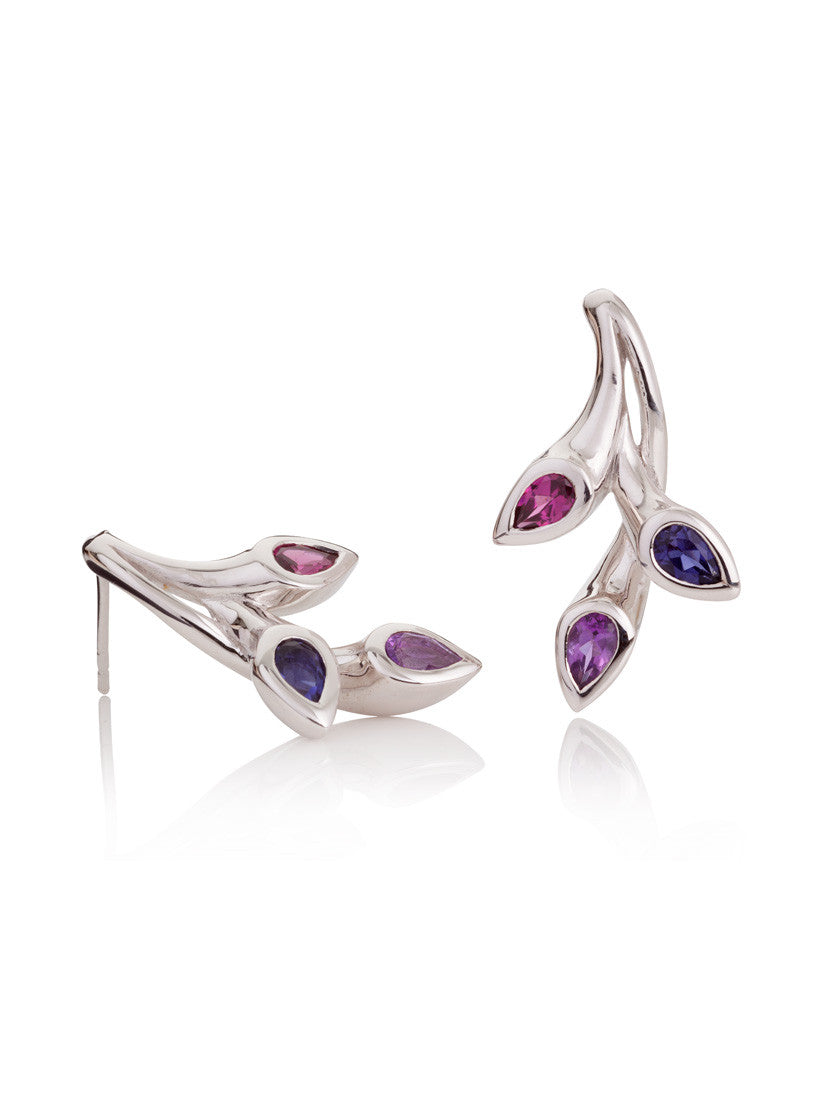 Rhodium plated sterling silver earrings set with a sparkling Amethyst, a Rhodolite and an exquisite Iolite.