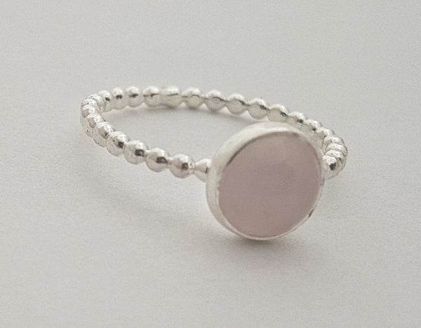 Rose quartz ring on beaded band