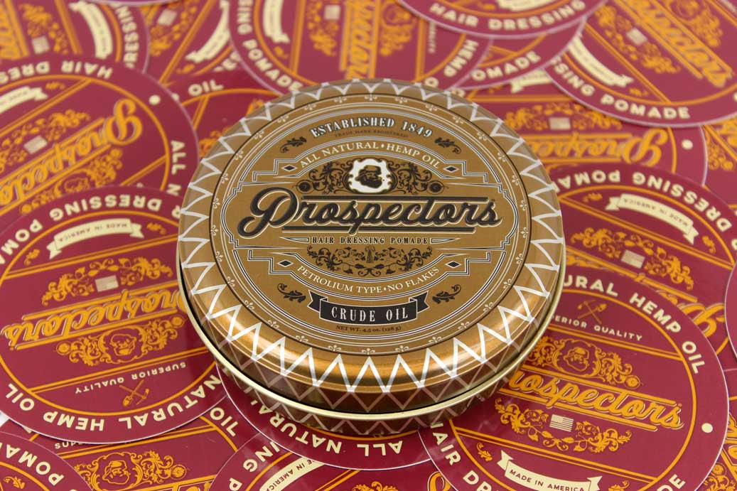 prospectors pomade gold tin can with stickers and red