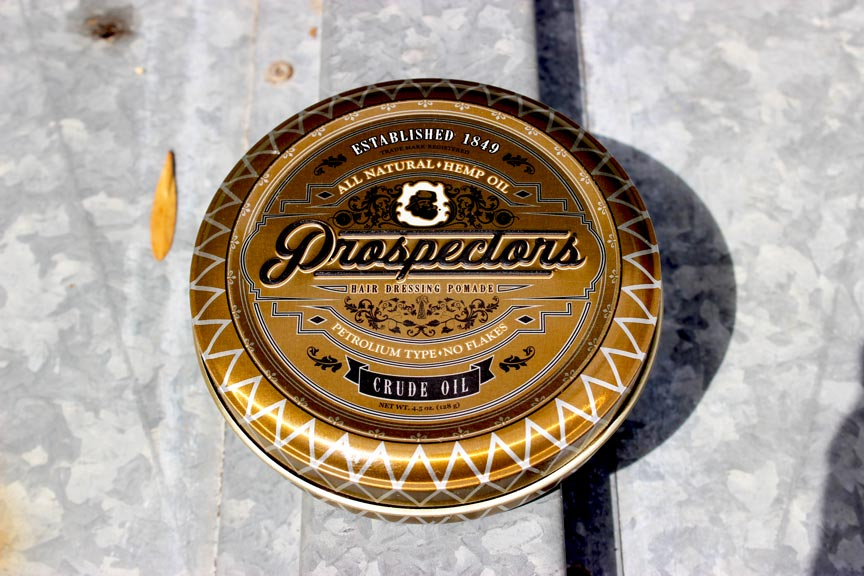 a beautiful can of prospectors pomade in the sunlight