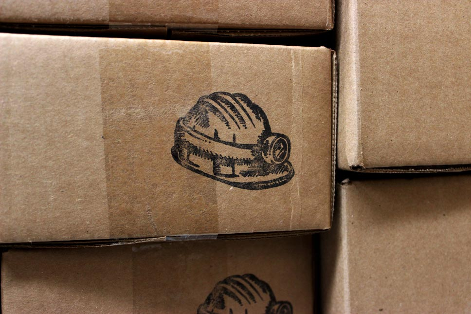 close up shot of logo on shipping box prospectors pomade