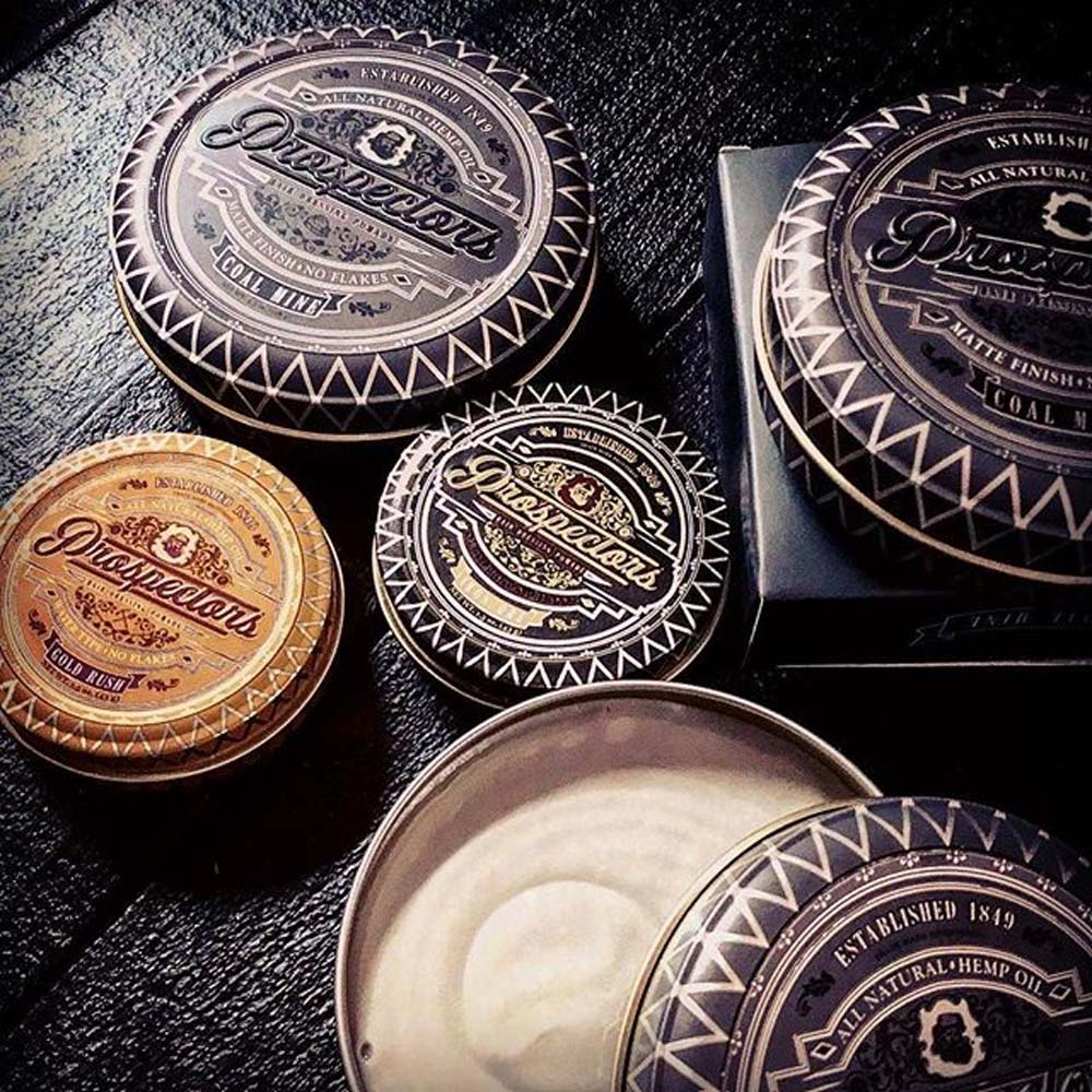 Prospectors Pomade Assorted Cans on Black Table