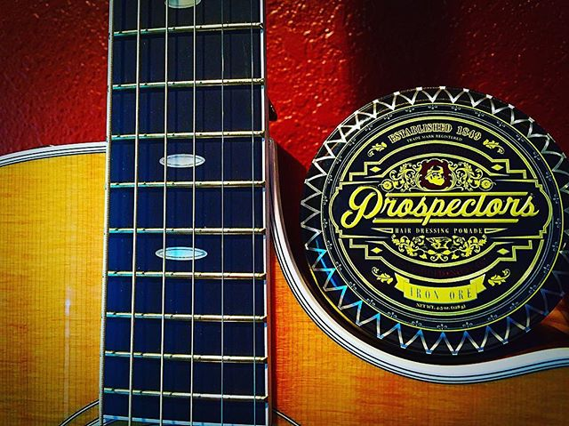 acadiana_barber_company prospectors pomade on a guitar