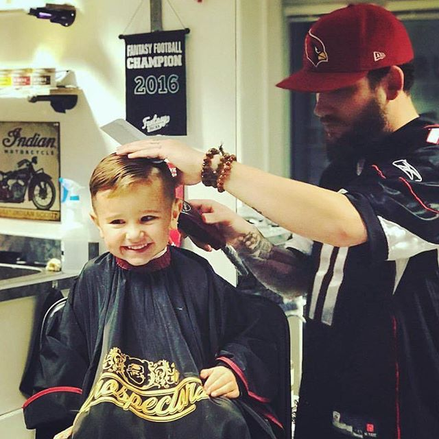 barberdave411 haircutting a young child hair in barbershop
