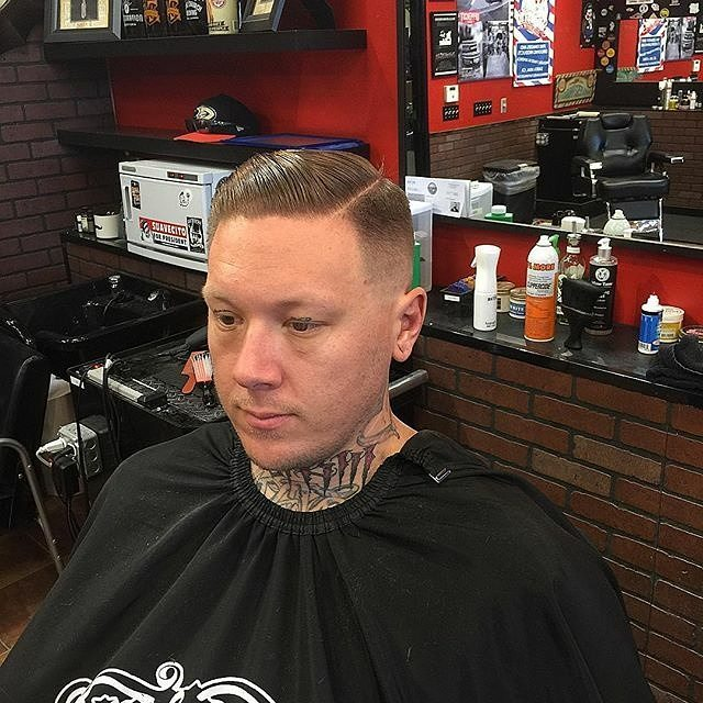 crownandstache barbershop haircut for a gentleman with prospectors pomade in the hair