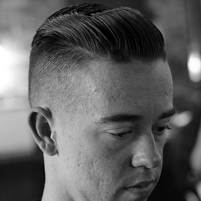 deadthebarber with a high skin fade and slick back prospectors pomade is used