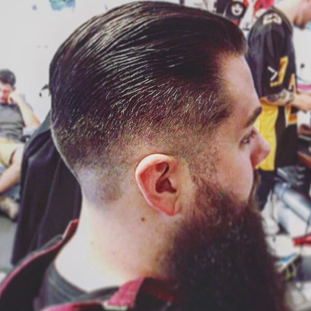 medium fade haircut and slickback with huge beard styled with prospectors pomade