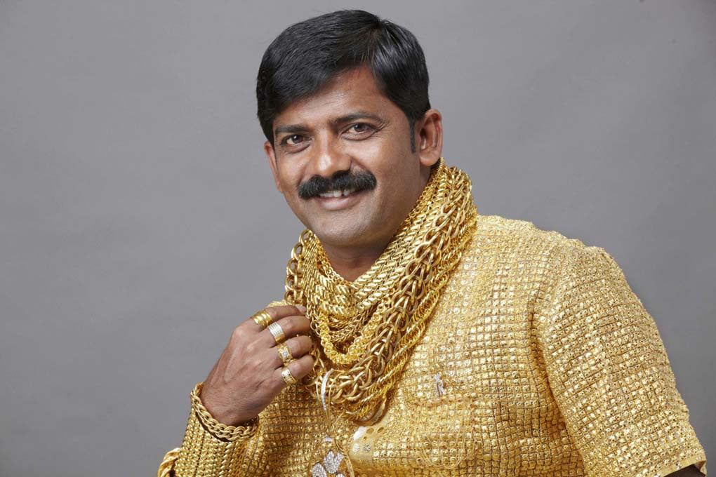 indian man covered in gold with black hair
