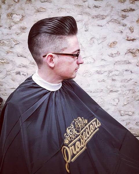 Proper Cut On A Gentleman In A Prospectors Barber Cape