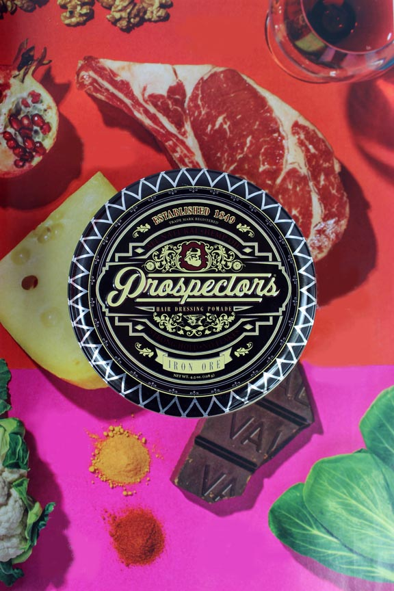 prospectors-iron-ore-water-based-pomade-with-food-background-and-colorful-imagery
