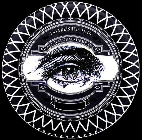 The all seeing prospectors pomade eye encased in glass