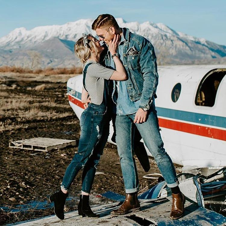 Man and Women Kissing on a plane wing in the mountains