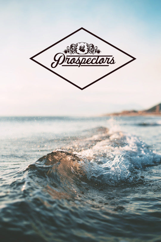 portrait of ocean waves with prospectors logo on top