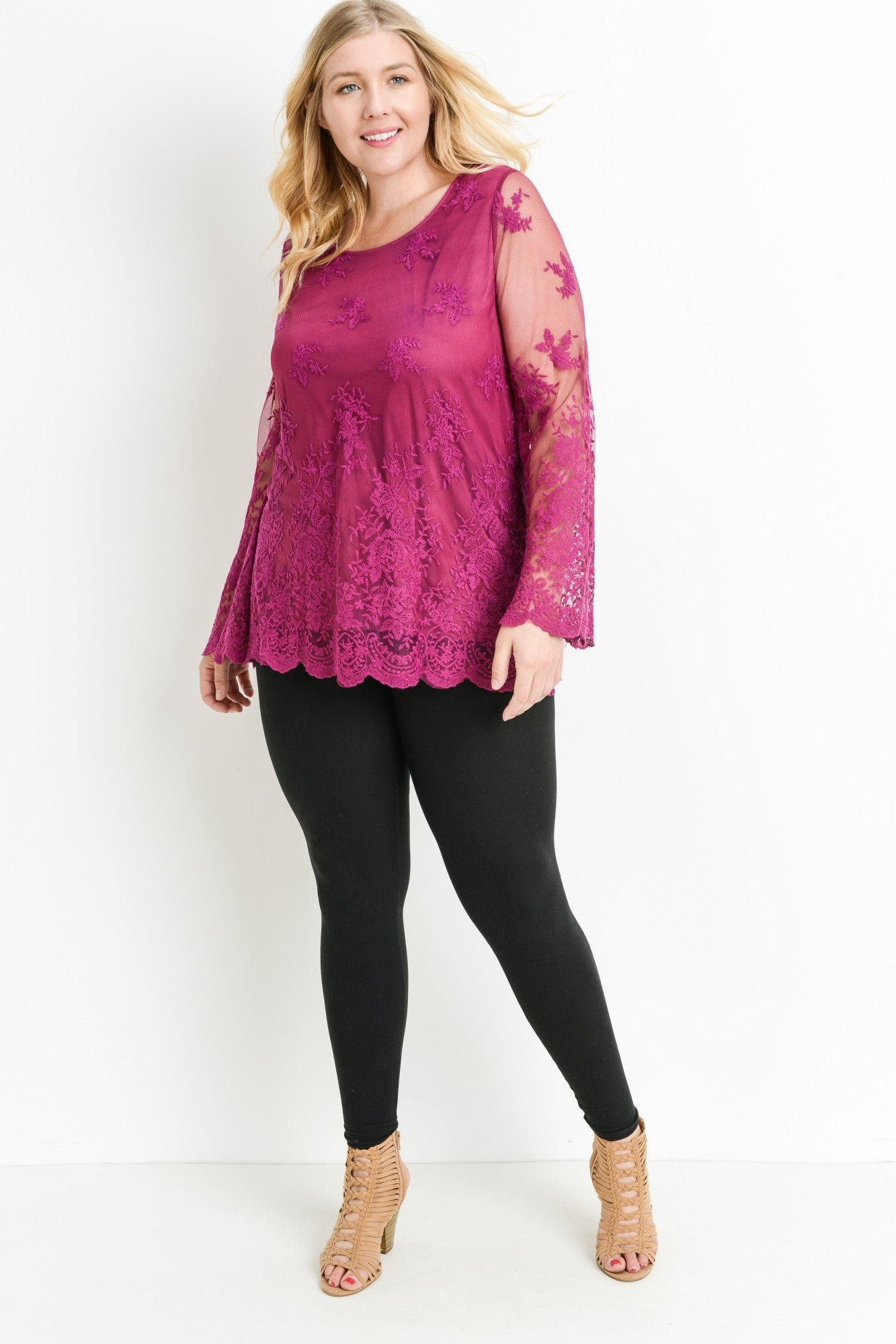 Front full view young woman wearing berry plus size tunic top