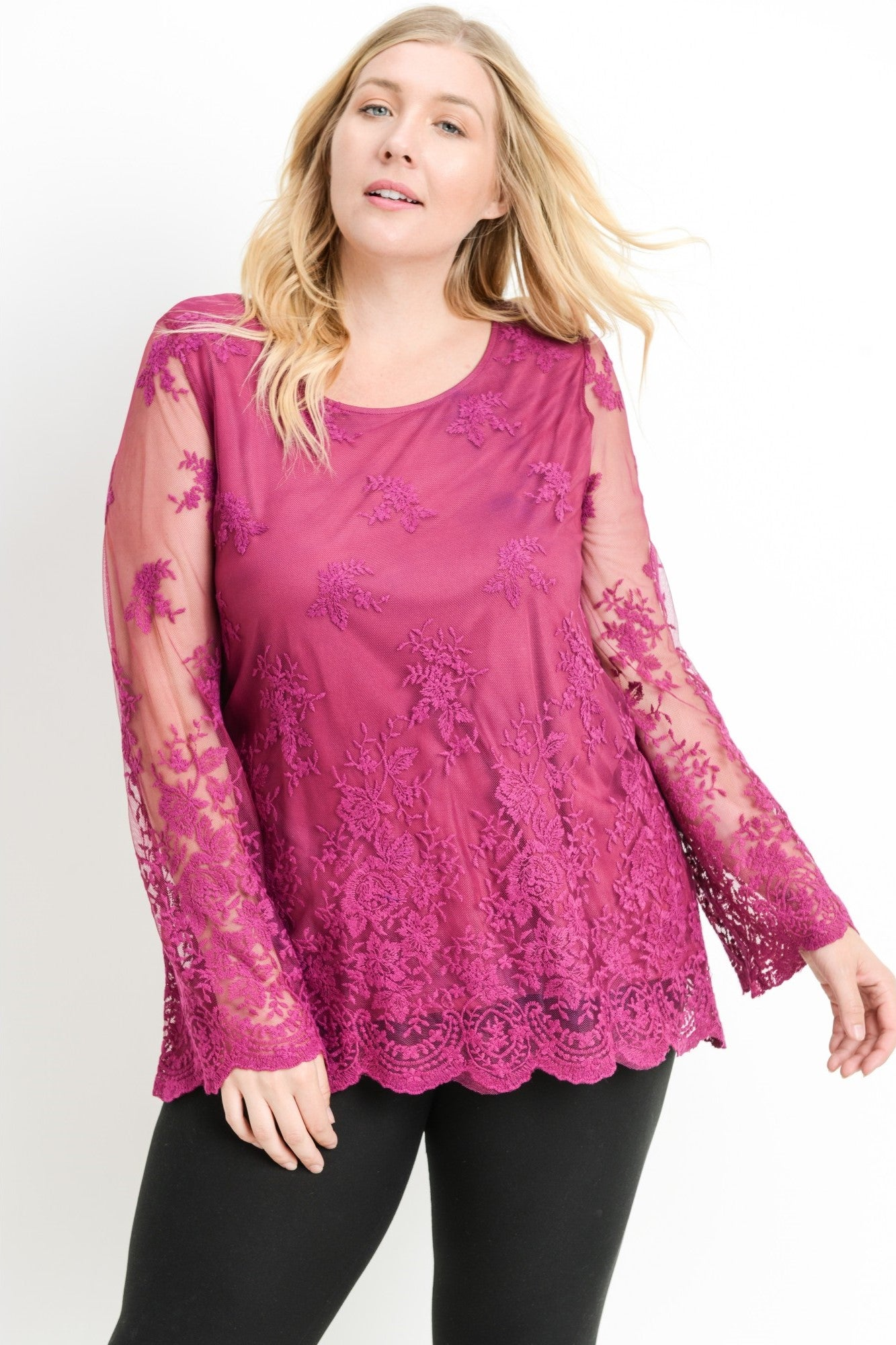 Front view young woman wearing berry plus size tunic top
