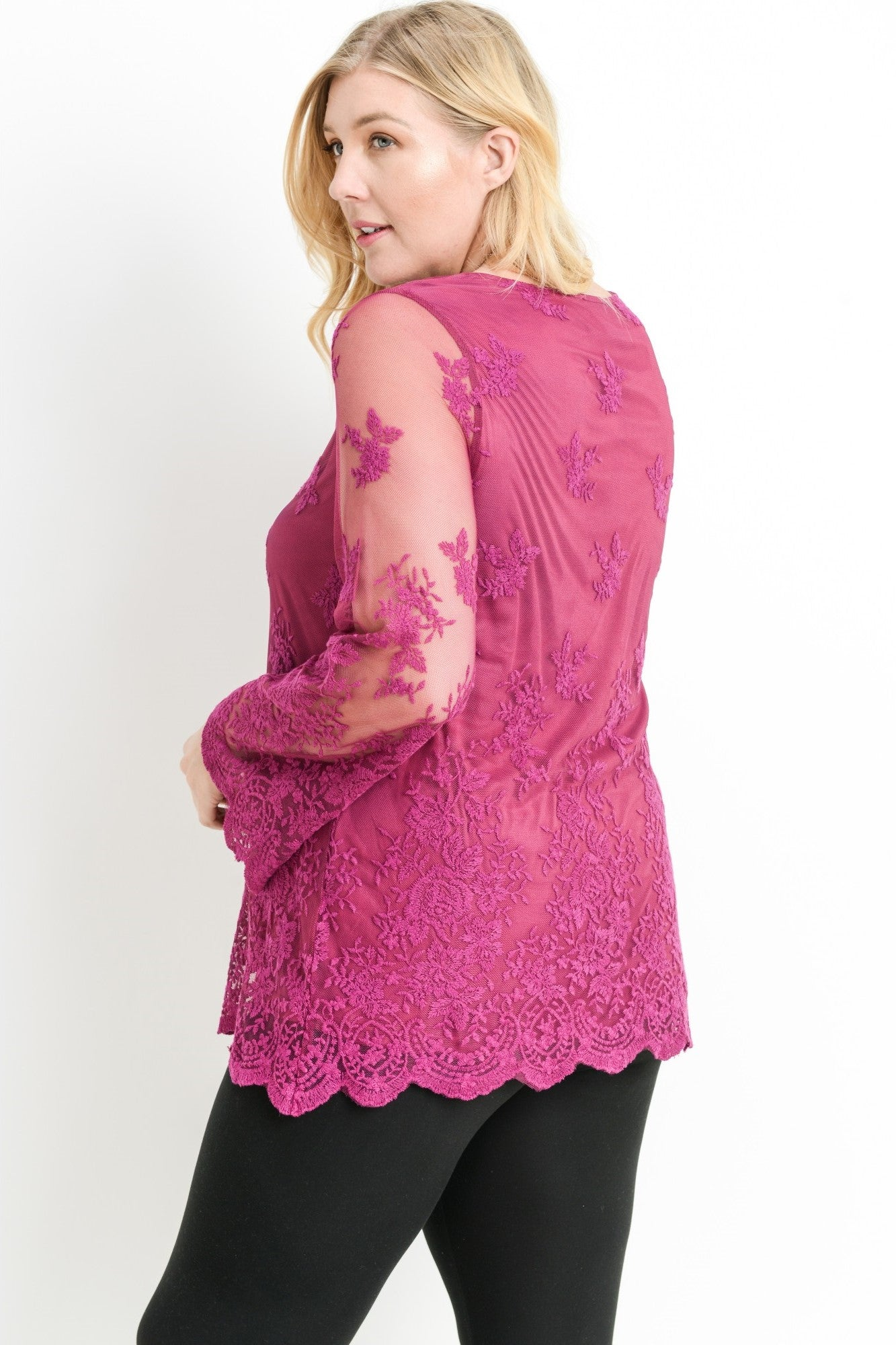 Back view young woman wearing berry plus size tunic top