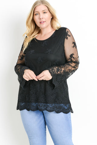 Front view young woman wearing black plus size tunic top