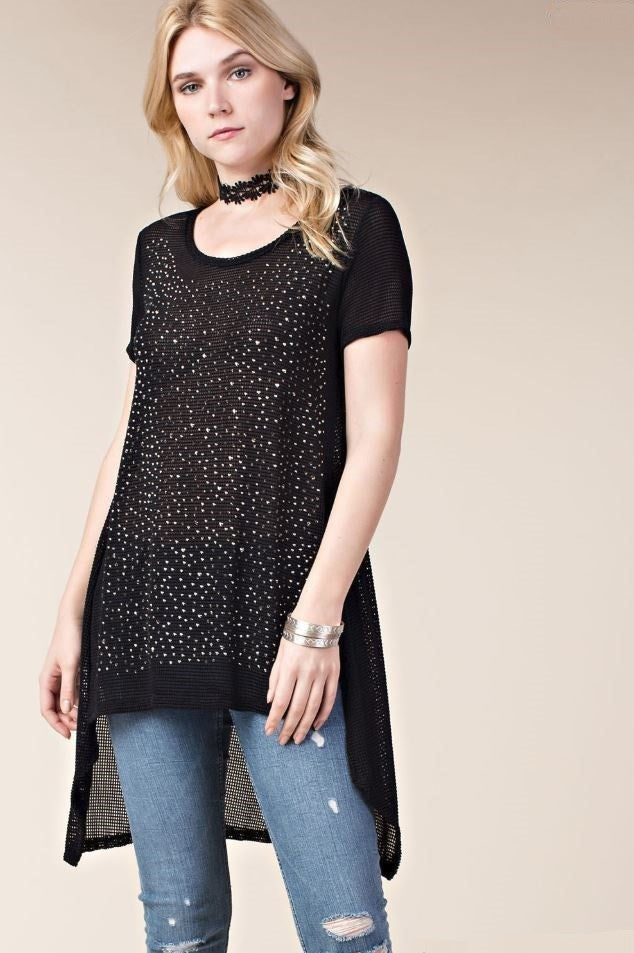 Front view young woman wearing black short sleeved high low tunic top with scattered studs