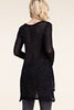 Back view woman wearing black long sleeve studded tunic top