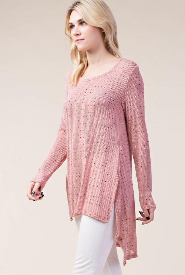 Left 3/4 view woman wearing semi sheer pink studded high low tunic top