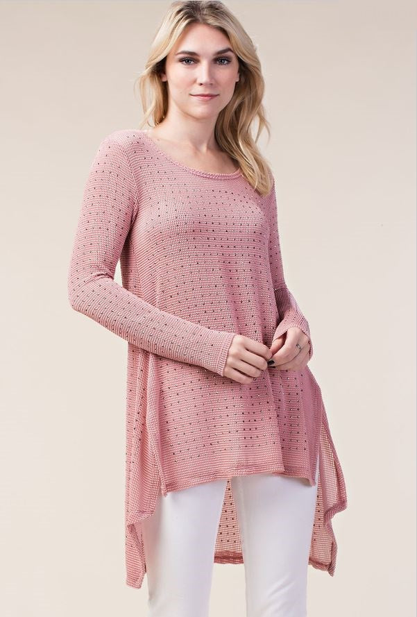 Front view woman wearing semi sheer pink studded high low tunic top