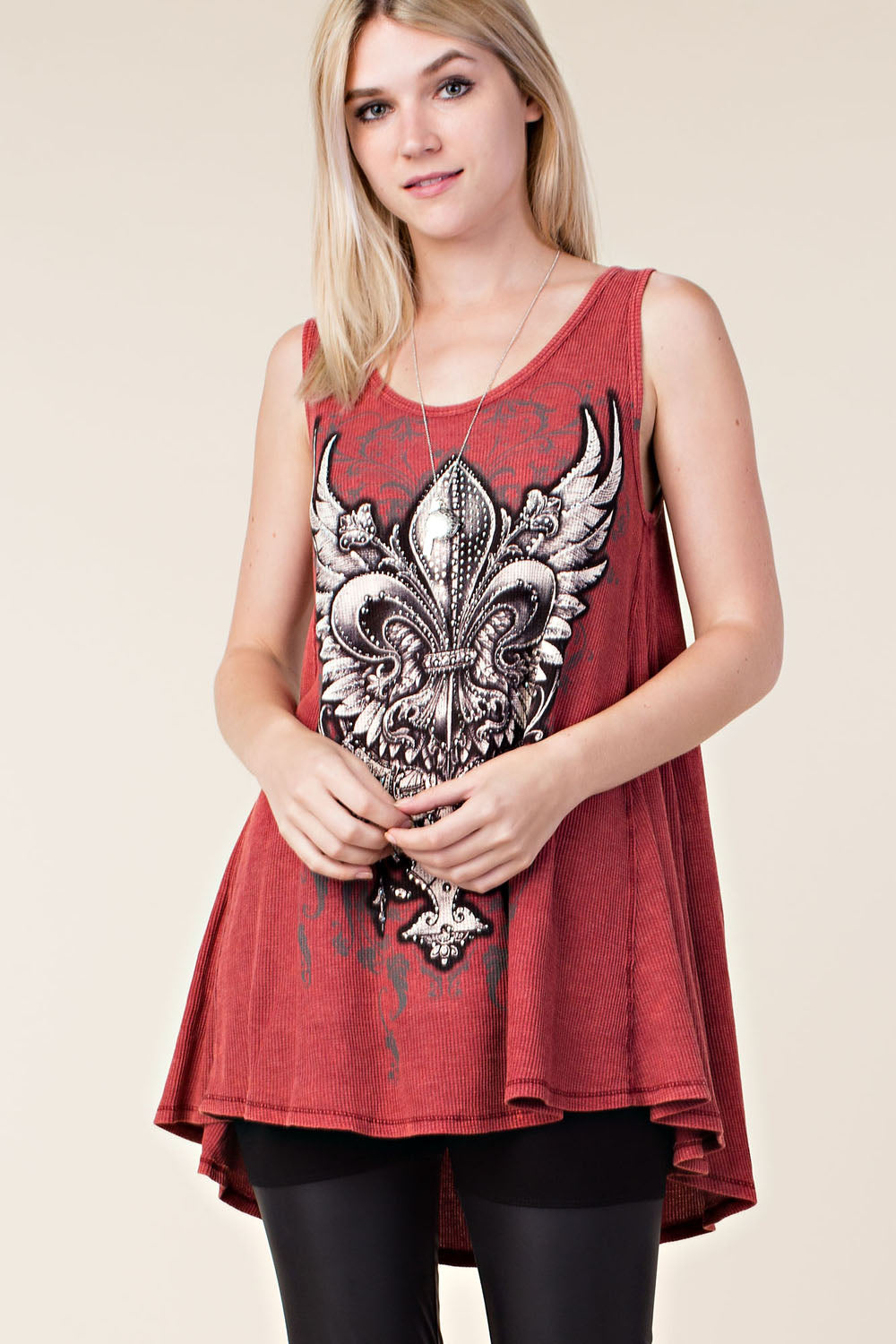 Front view young woman wearing red printed tank tunic top with silver studs and rhinestones