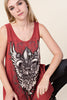 Front detail view young woman wearing red printed tank tunic top with silver studs