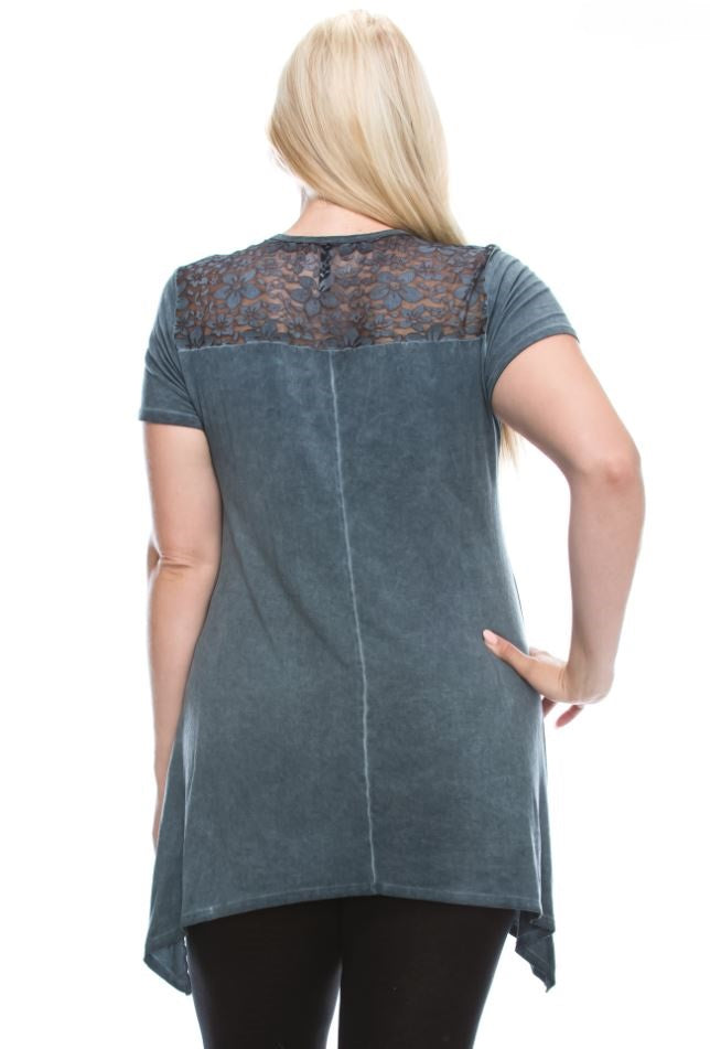 Back view plus size young woman wearing blue short sleeve print tunic top with studs