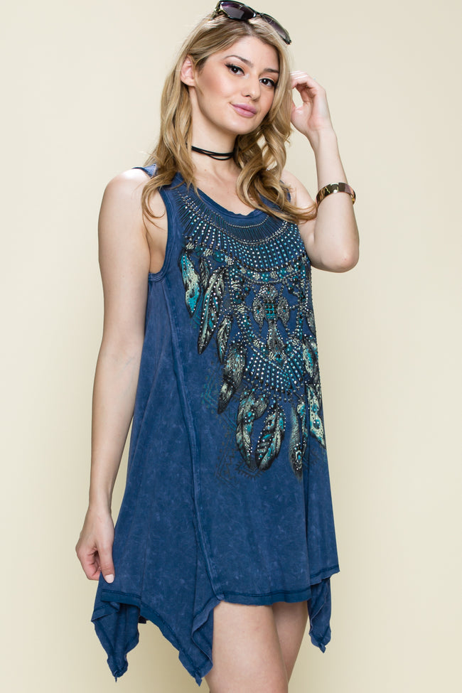 Front view young woman wearing blue swing tank top with feather print and stones