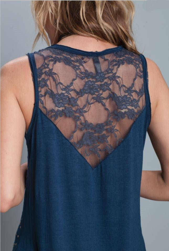 Back detail view blue high low ruffle trim tank top with studs