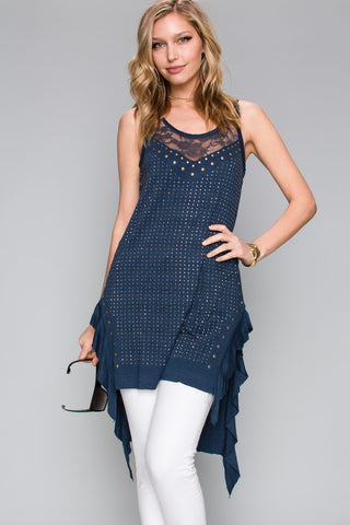 Front view woman wearing blue high low ruffle trim tank top with studs