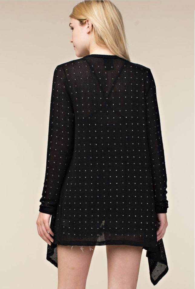 Back view young woman wearing black lightweight open-front studded cardigan