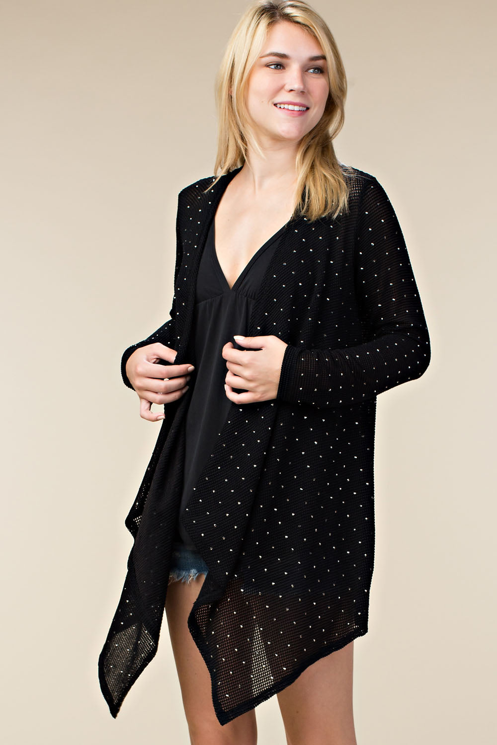 Front view young woman wearing black lightweight open-front studded cardigan