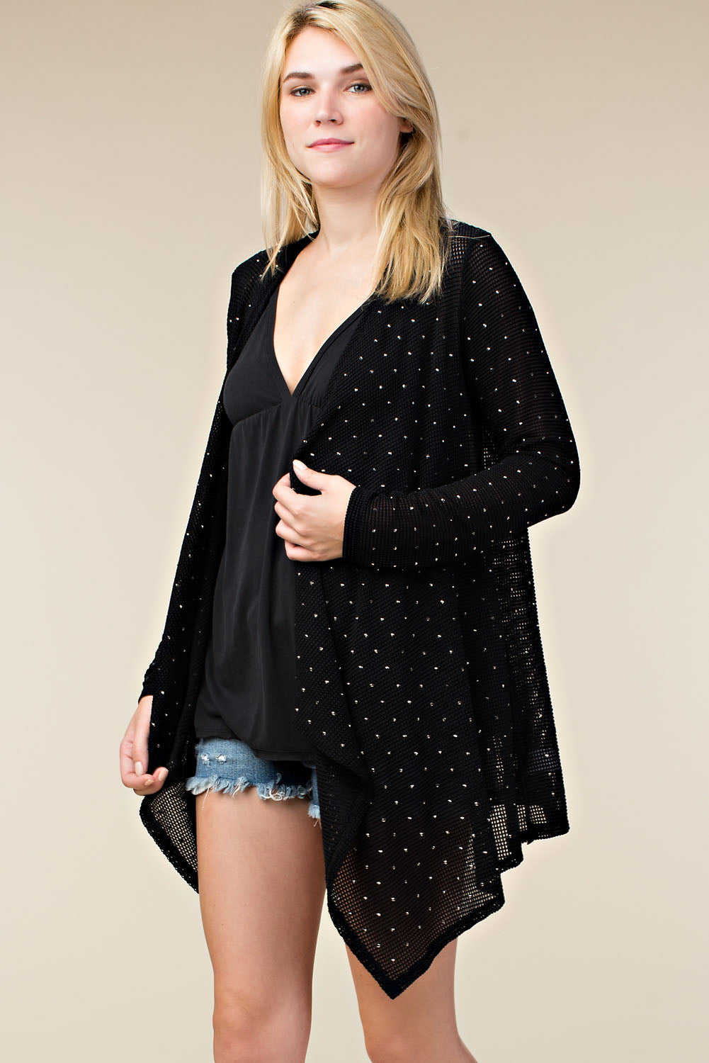 Front/left view young woman wearing black lightweight open-front studded cardigan
