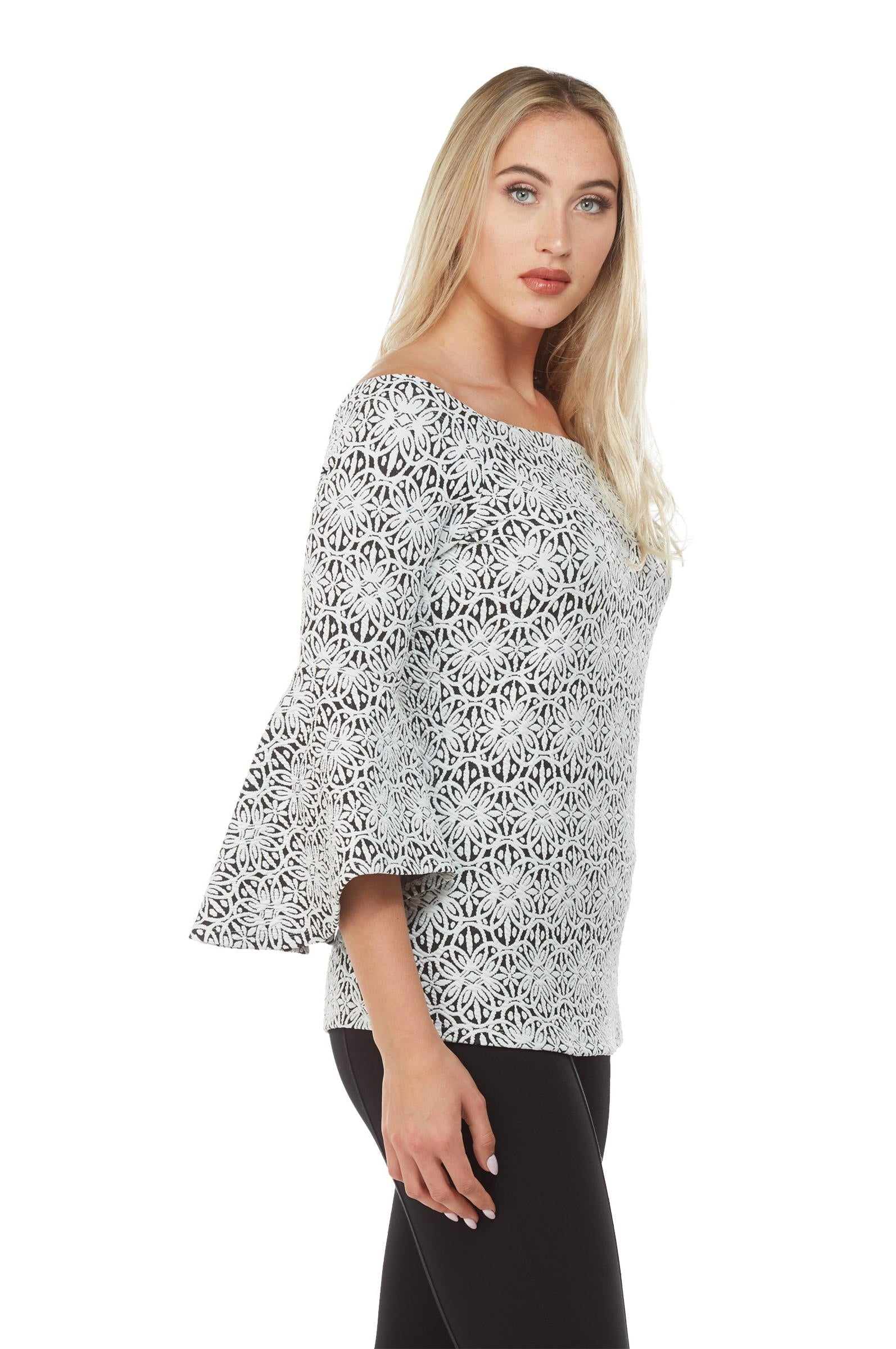 Side view woman wearing black/white off the shoulder jacquard knit  bell sleeve top