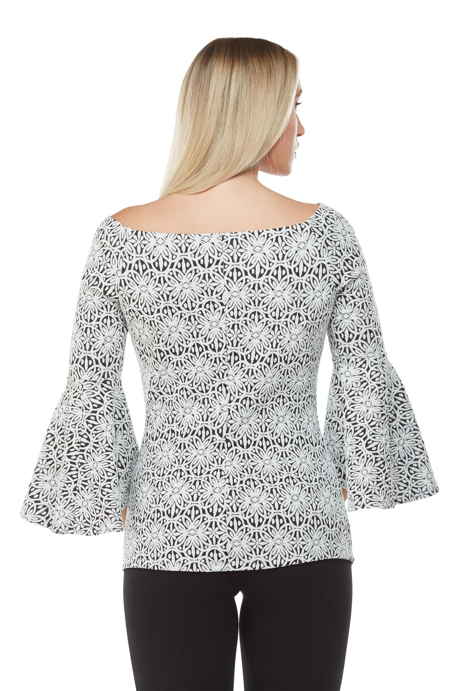 Back view woman wearing black/white off the shoulder jacquard knit  bell sleeve top
