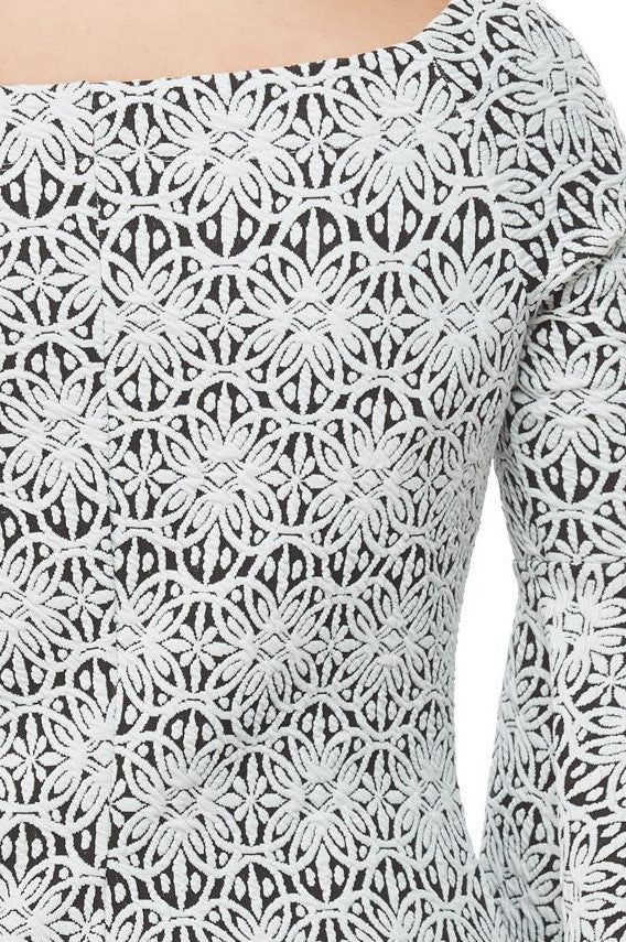 Detail view black/white off the shoulder jacquard knit  bell sleeve top