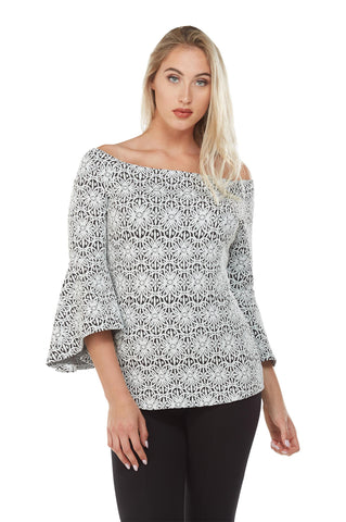 Front view woman wearing black/white off the shoulder jacquard knit bell sleeve top