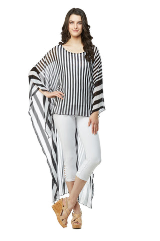 Front view woman wearing extreme high low tunic top in black and white stripes