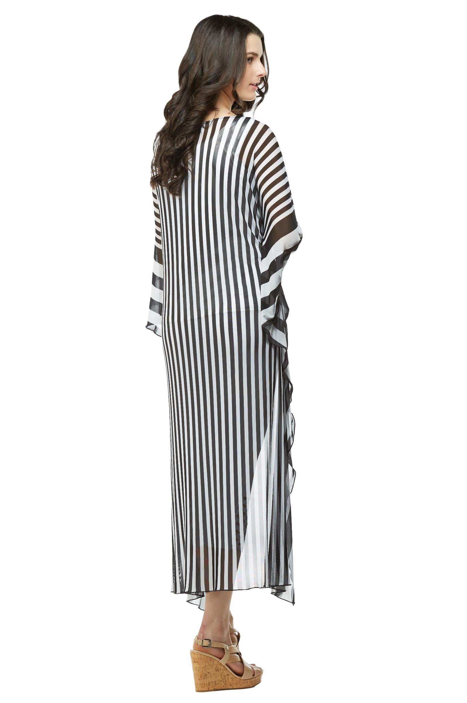 Back view woman wearing extreme high low tunic top in black and white stripes