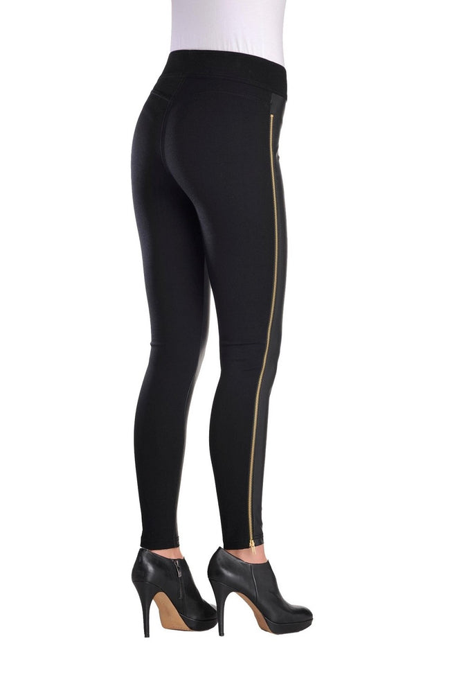 Back view woman wearing black pleather-front leggings with full side gold zipper from Nygard Slims