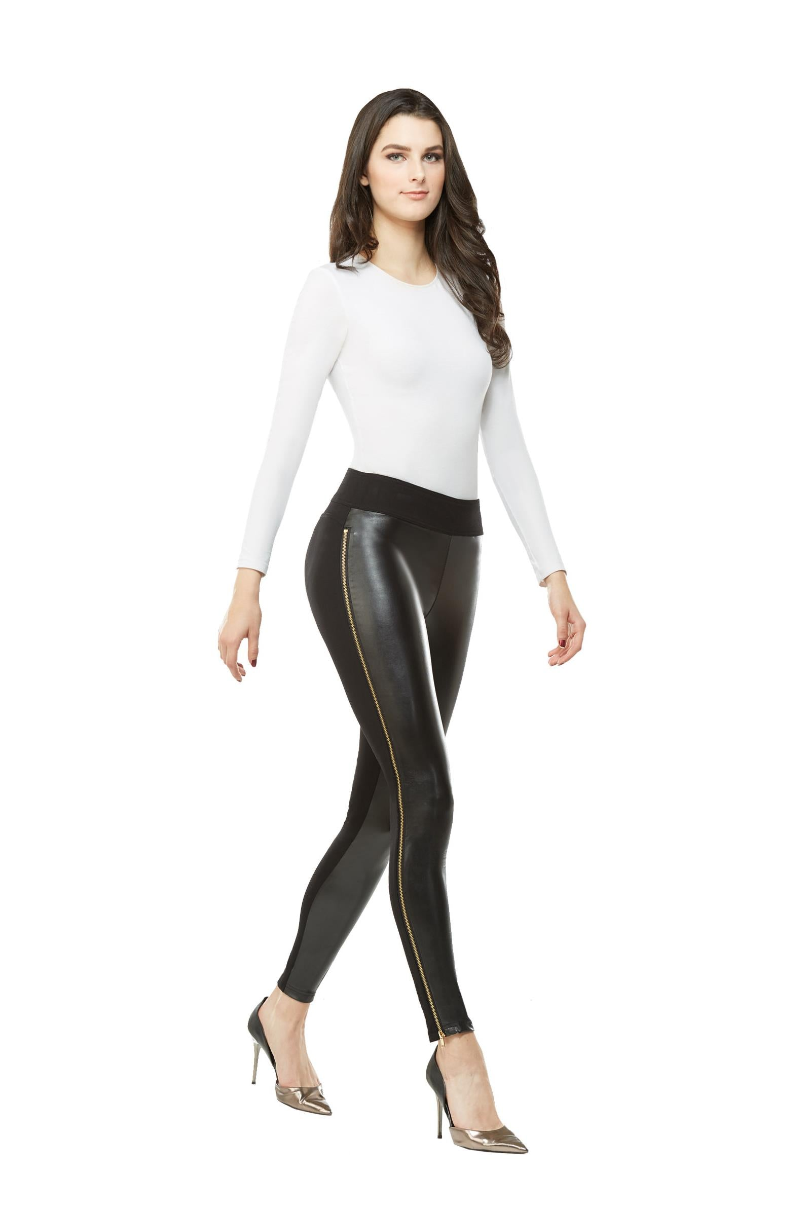 Full view woman wearing black pleather-front leggings with full side gold zipper from Nygard Slims