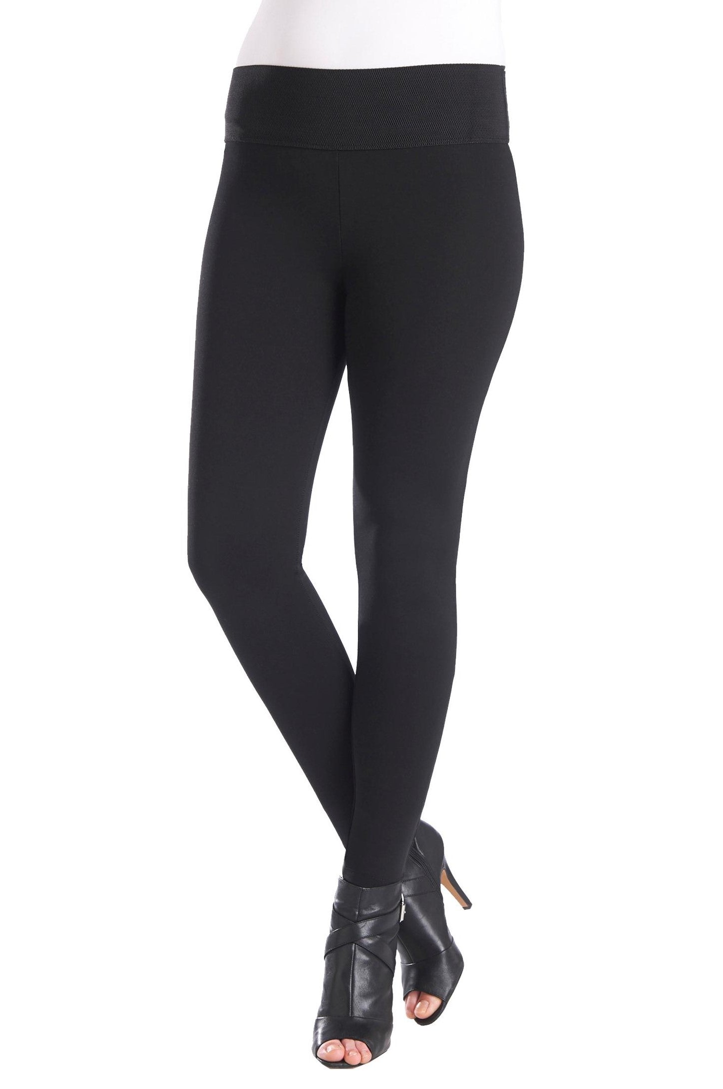 "Front view woman wearing black compression leggings with wide 3.5"" waistband from Nygard Slims"