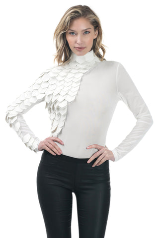 Front view young woman wearing off white long sleeve mesh bodysuit with pleather scales